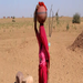 A woman carrying water. Women and girls can walk several hours each day to ensure their families have sufficient water.