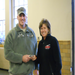 Mary Stebbins from Marks Feed Store Resturants gives gift cards to Major Brian Combs that they collected.