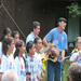 "Henry leading Kids4Peace Vermont in ""We Shall Overcome"""