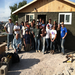 Two work groups in front of a finished house