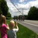 Families giving thanks as riders pass.