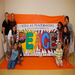 Elementary-age children learn about peacemaking, then make a mural to express their own peace message to the community.
