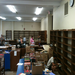 Volunteers start to unload sorted boxes of books after a tutorial from the school district's library specialist.