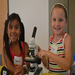 Learning to use the microscope at science summer camp