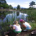 Campers learn about insects living in the pond