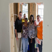Miss Cassandra and her neighbor with members of the April group of Mission 2013: New Orleans