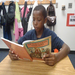A student from an Annapolis area school reading a book provided as part of an outreach program.