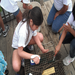 Elementary school students are encouraged to clean oyster cages to reduce fouling of the cages.