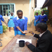 A teacher treating a school with Albendazole for intestinal worms
