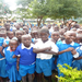 Kenyan school children waiting to be treated for intestinal worms