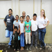 The family in front of their new home, with Common Hope construction staff.