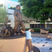 A child admiring the Cesar E. Chavez statue on the downtown Riverside Hero's Peace Walk