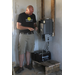 Eric Hansen our chief solar installer works on the inverter, charge controller and batteries on our Tanzania project.