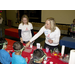 JLM volunteers do science experiments with children through the H.O.M.E.S. program.