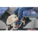 A recent photo of Hero as a fully grown dog. He's learning how to rest at his puppy raiser's feet while riding the bus.