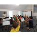 Cecilia conducts new string students.