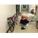 Putting her bike together in Bangkok - just one part missing???