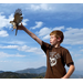 A boy scout releasing a Sharp-shinned Hawk at the Goshute Mountains, NV migration site.