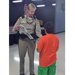 A metro officer speaks with a student participating in Play by the Rules