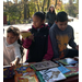 Students choosing books on field trip to Burgundy Farm.