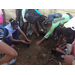 Students prepare soil to grow plants for science class. GEP engages students in hands on projects in their own language.