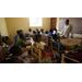 Principal Dalix Mathurin leads a conversational English class.