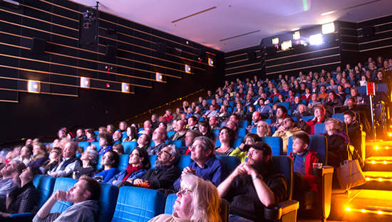 Size 550x415 audience in theater