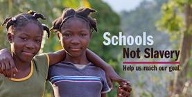 Schools not Slavery banner