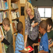 Baldwin County Bookmobile Librarian Gloria Shores helps Head Start students find the perfect book