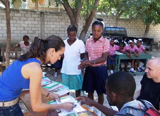Size 550x415 ayiti now corp book bank education haiti book team 3