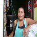 With her first loan, Alma has expanded from just selling dairy products to also running a small basic goods store.