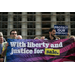Activists hold up a banner during a rally against money in politics, at the Supreme Court in Washington, on October 8.